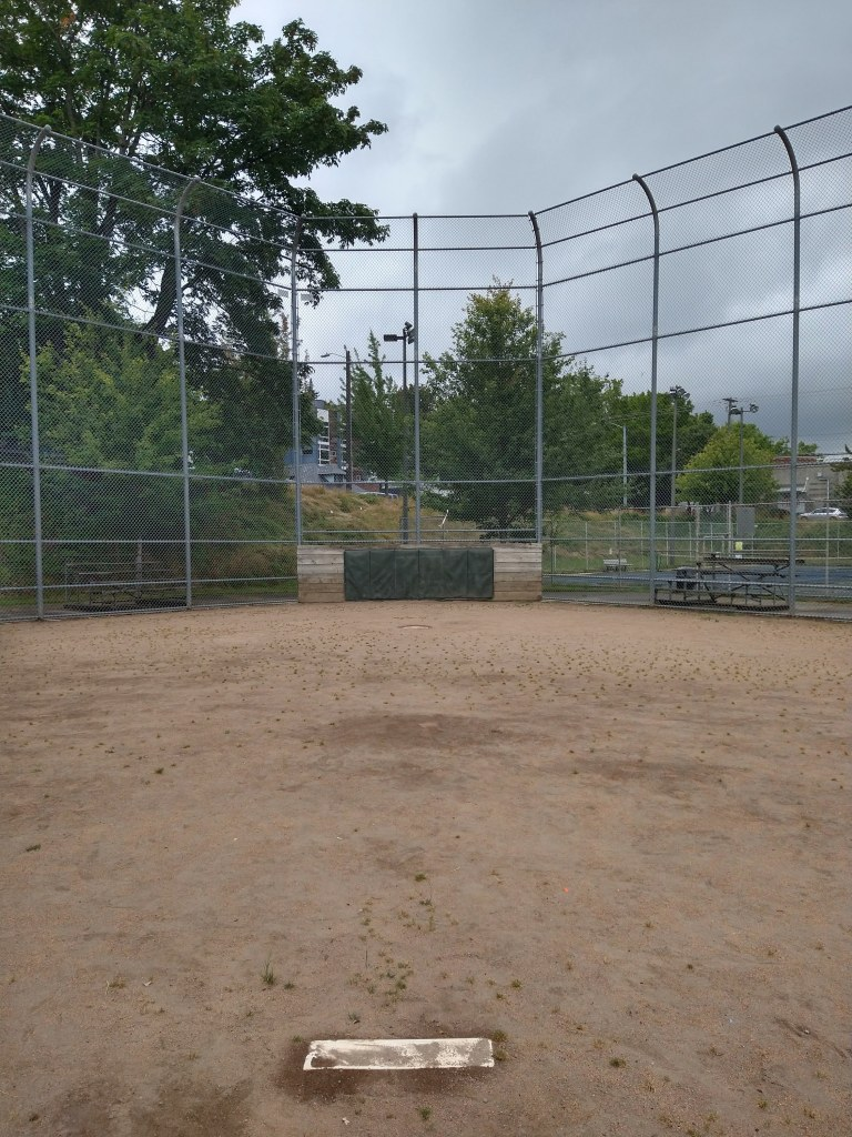 A baseball diamond from the perspective of the pitcher.