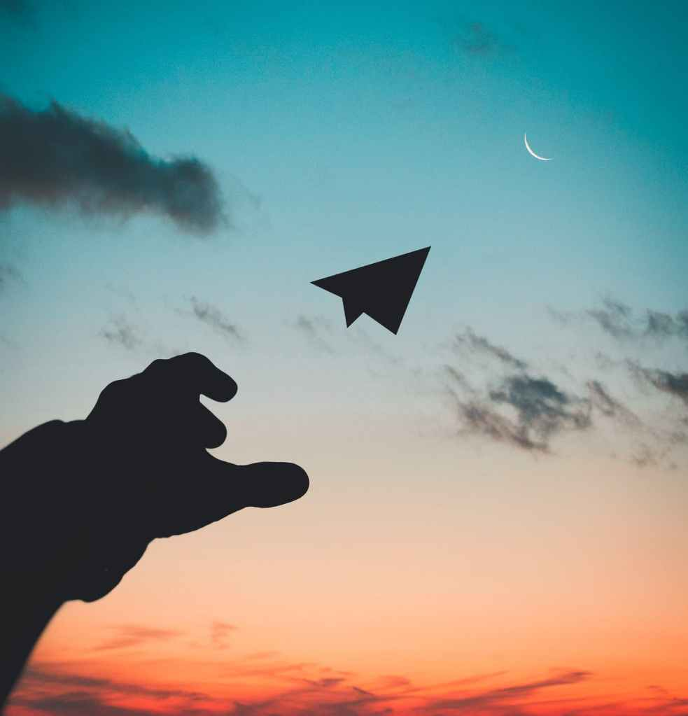 Throwing a paper plane to the moon, wishing for a better life